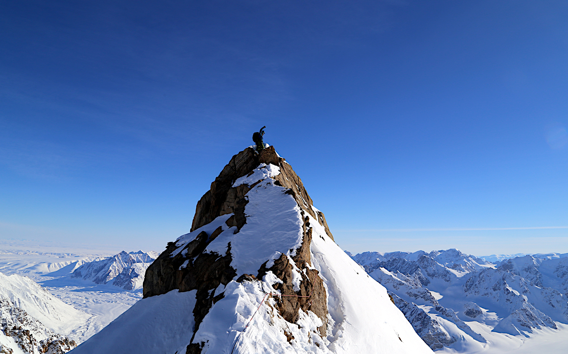 Photo of me on the first ascent of Boughfell, the second preivous unclimbed peak we climbed during the 2017 Greenland Expedition.